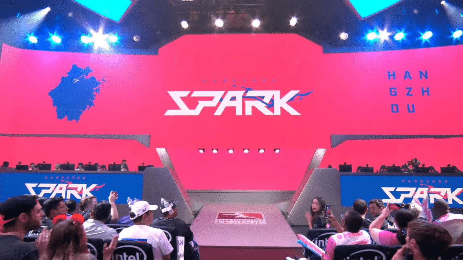 The team set up on the stage for a Hangzhou Spark homestand in pinks and whites.